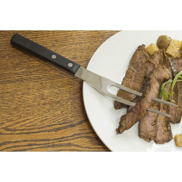 Sliced skirt steak on a plate.