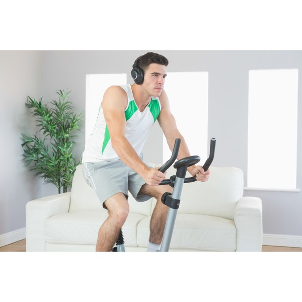man exercising on exercise bike