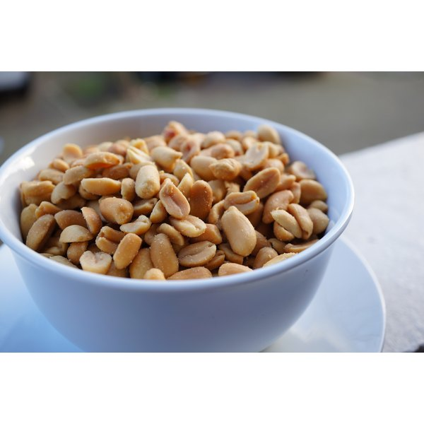 A bowl of roasted peanuts.
