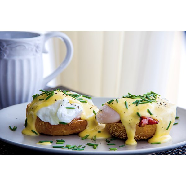 A plate of eggs benedict on a table.