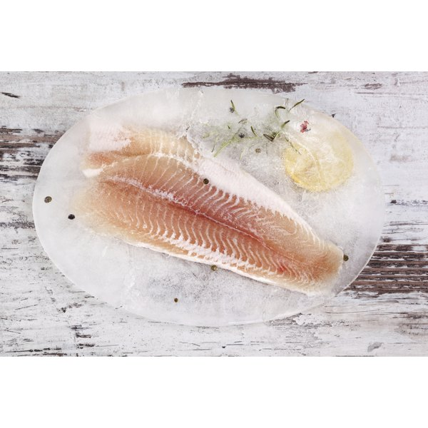 A raw fish fillet on a table.