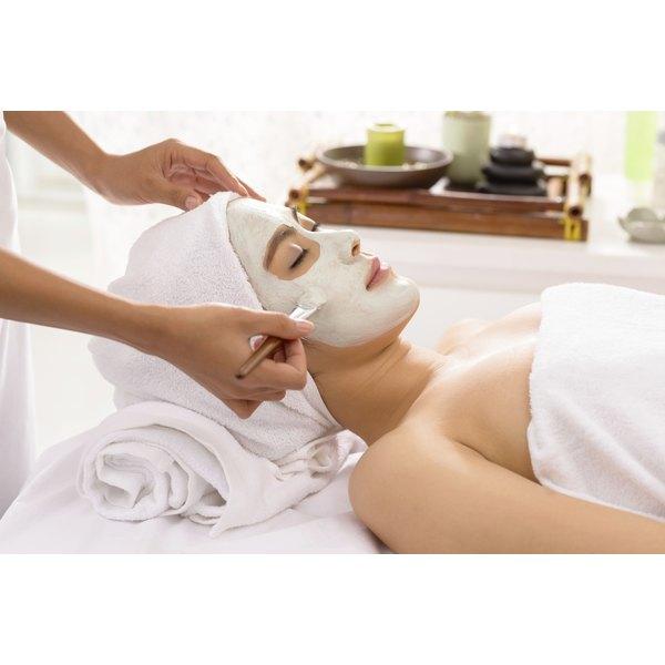 A woman having a facial at a spa.