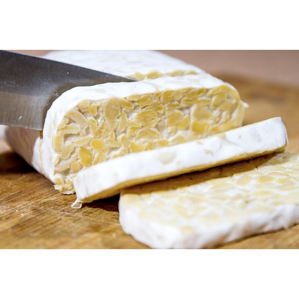Close-up of tempeh being sliced.
