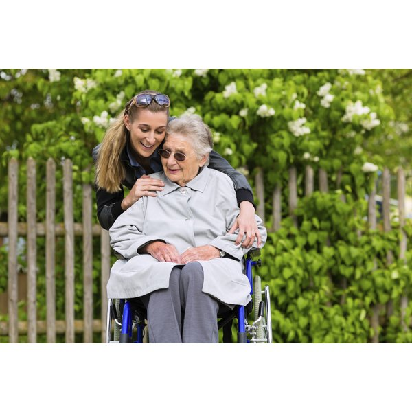 Young woman hugging nursing home resident