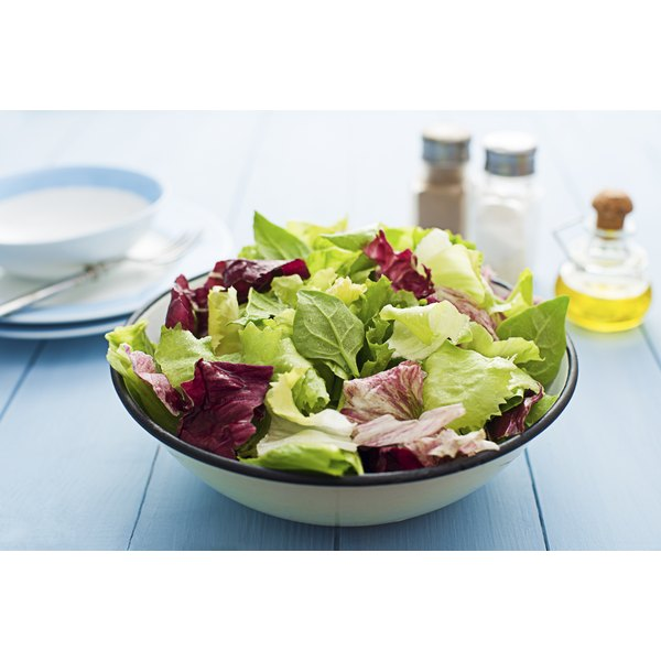 A bowl of assorted salad greens.