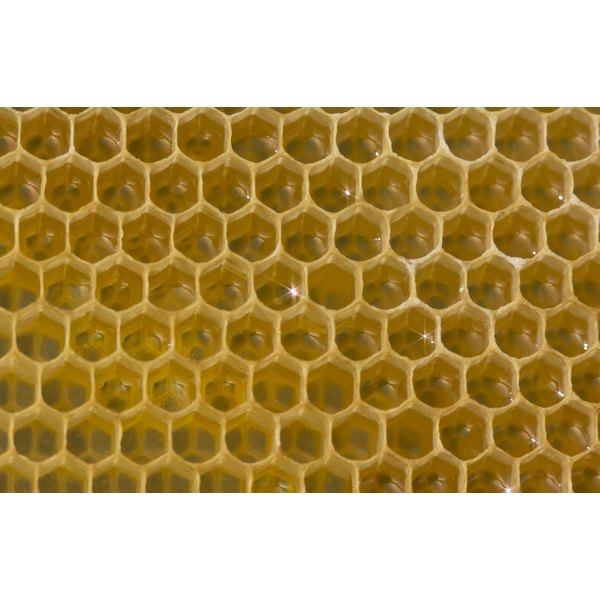 Nectar and honey in a honeycomb.