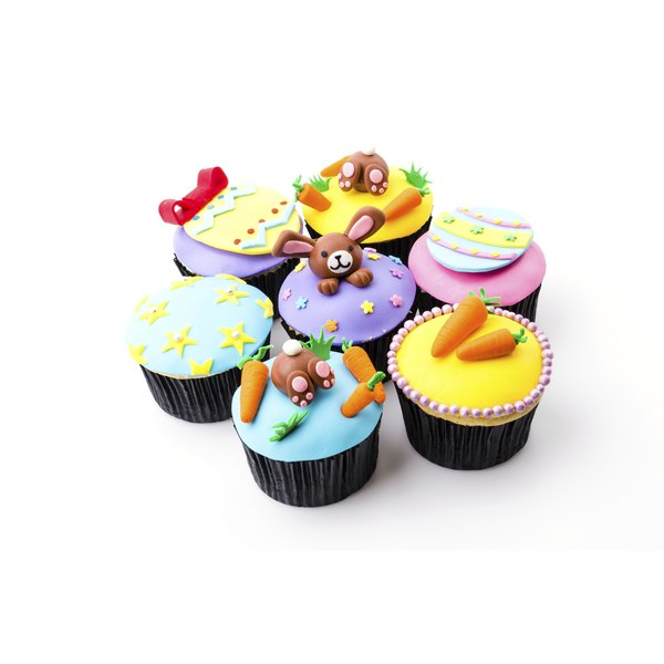 Plastic icing is cut and molded into a variety of shapes.