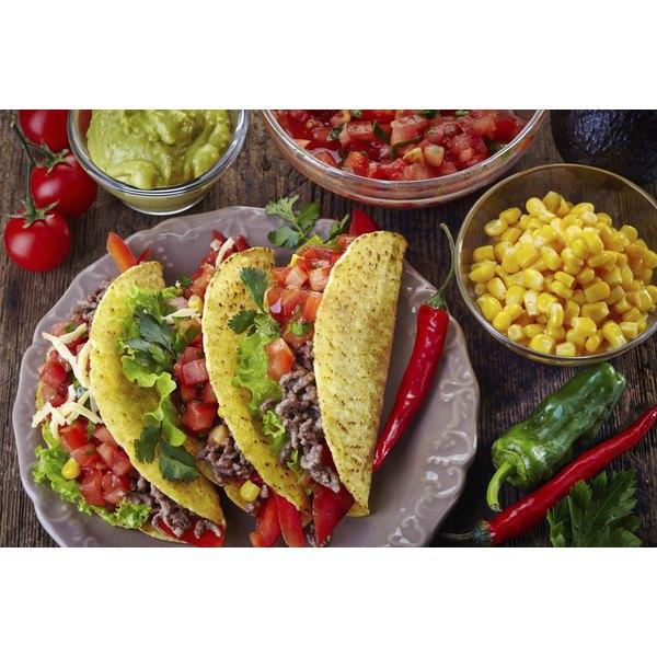 Three crunchy tacos on a plate.