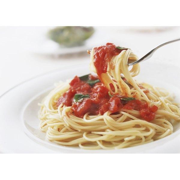 Pasta with marinara sauce twirled around a fork.