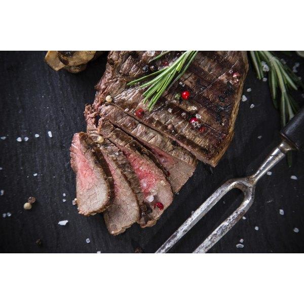 Sliced beef tenderloin on a table.