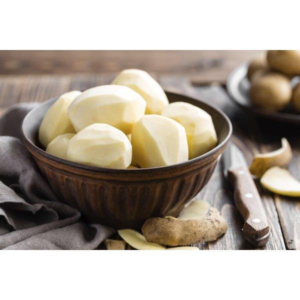A bowl of peeled potatoes.