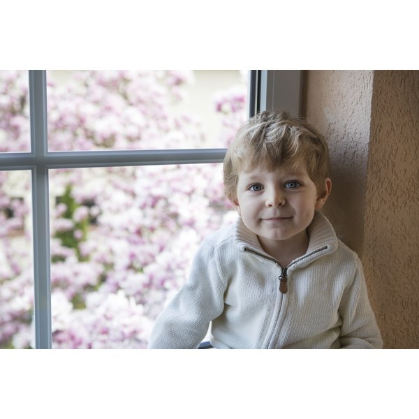 toddler boy near window
