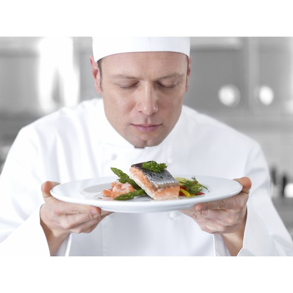 A chef prepares wild salmon for a meal.