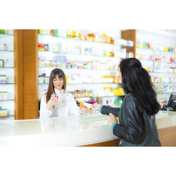 A female pharmacist discusses medicaiton with a female customer.