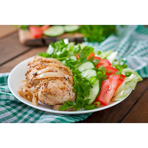 Chicken breast with a small salad.