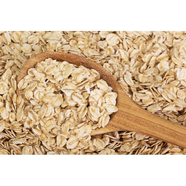 A large spoonful of dried oats.