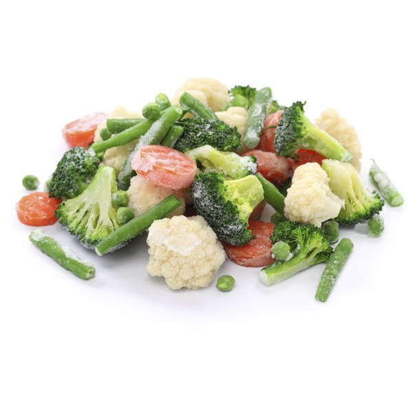 Frozen vegetables sit on a white counter.