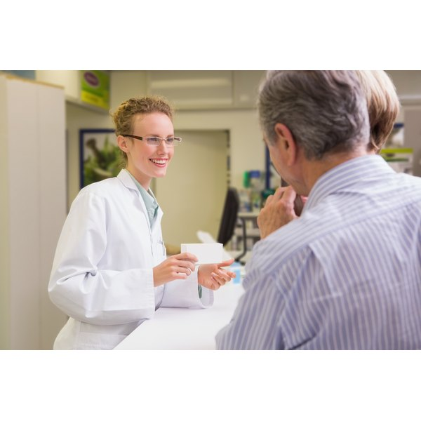 A pharmacist is talking to her customer.
