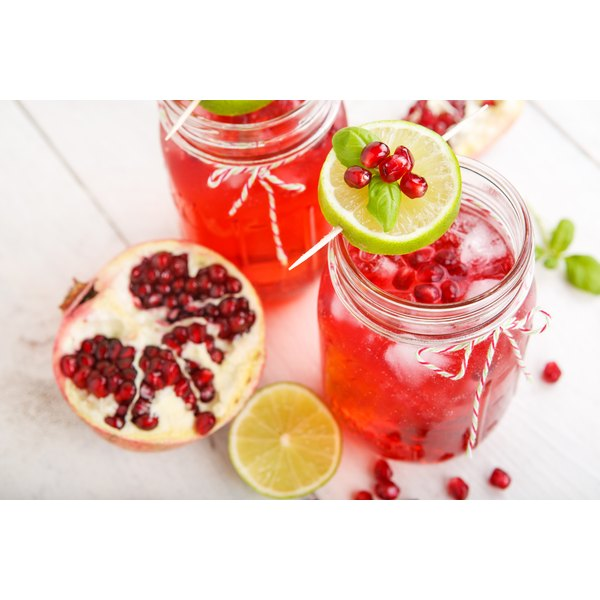 Two large mason jars filled with pomegranate juice.