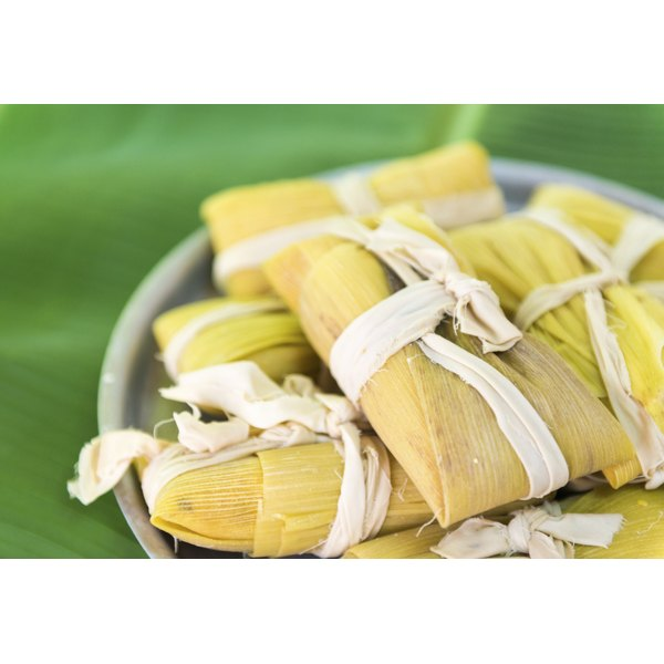 Homemade corn tamales in a dish.