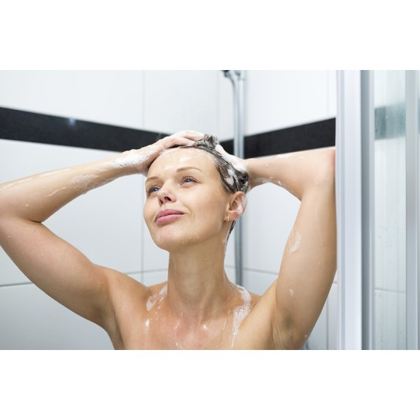 Woman in the shower washing her hair