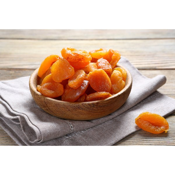 A bowl of dried apricots on table.