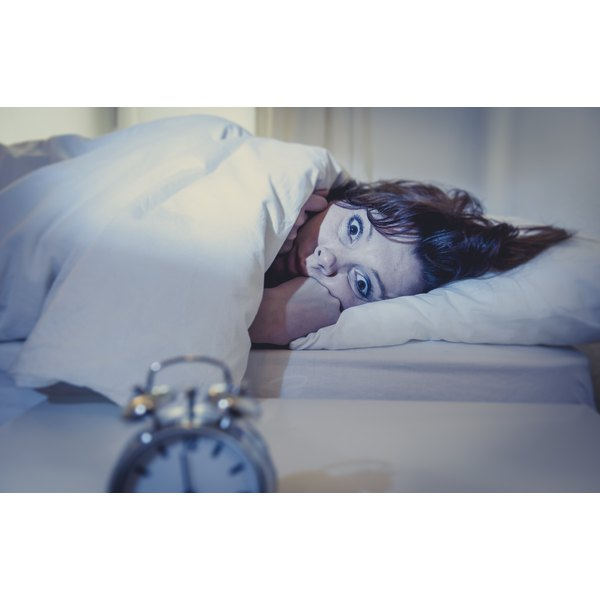 Wide-eyed woman in bed with insomnia