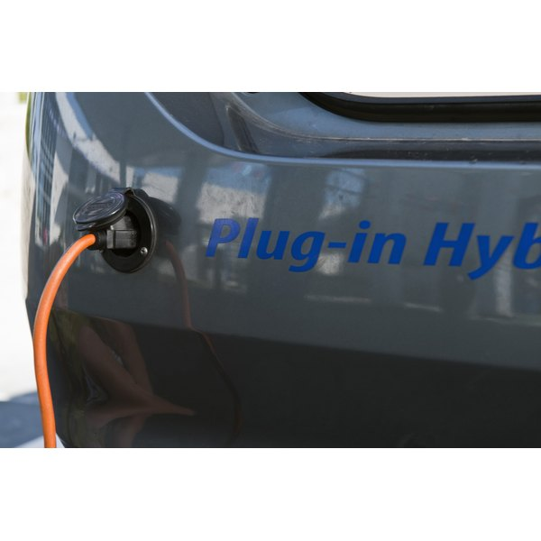 A hybrid car is plugged in.
