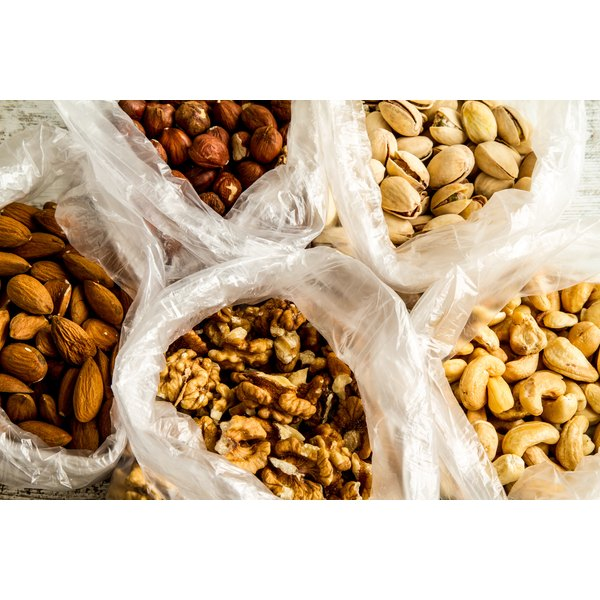 An overhead view of nuts in bags.