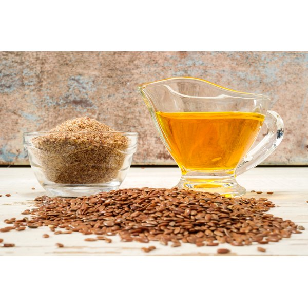 A cup of flaxseeds and flaxseed oil
