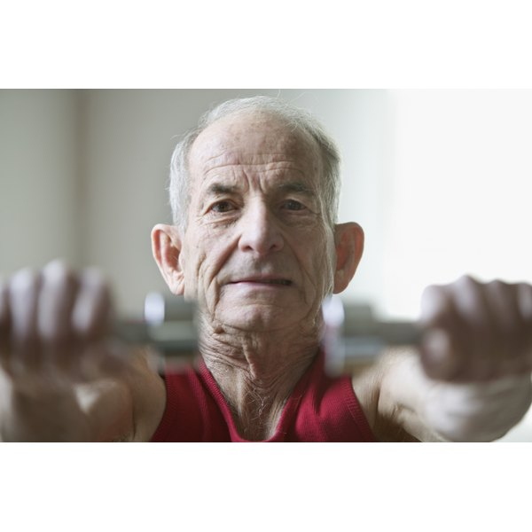 Elderly man exercising with weights