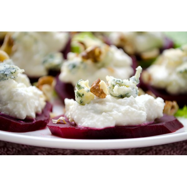 Sliced beets with goat cheese and walnuts.