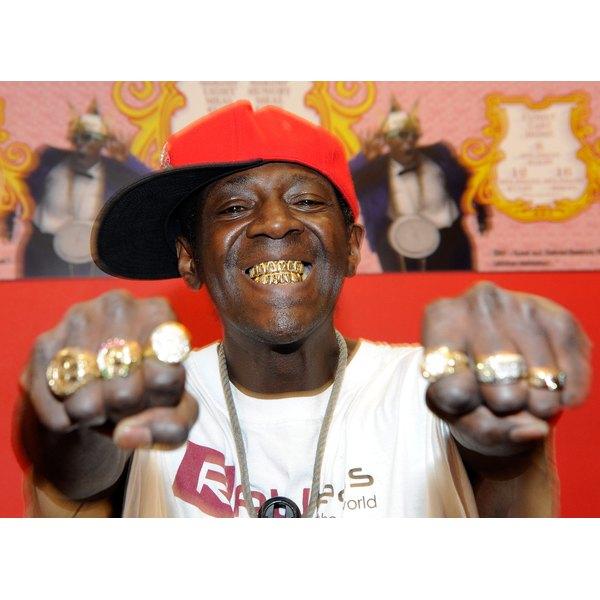 Rap artist Flavour flav smiles to show his grillz.