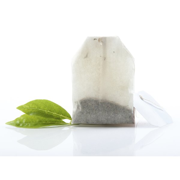 Tea bag with leaves.