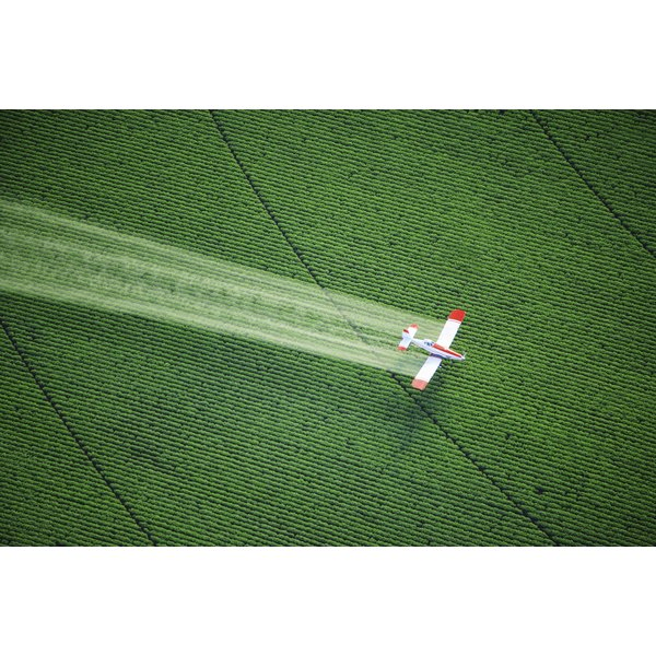 Crop duster over field