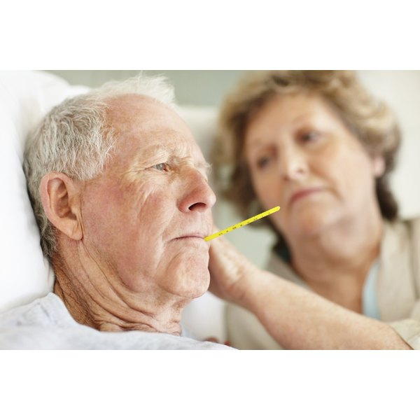 Senior man with thermometer in his mouth