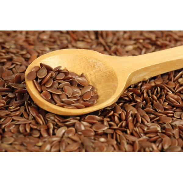 Flax seeds on a wooden spoon.