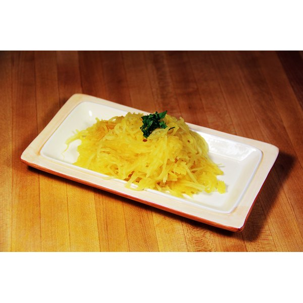 Close-up of cooked spaghetti squash pasta on a plate.