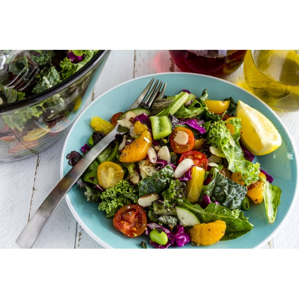 A healthy salad in a blue bowl.