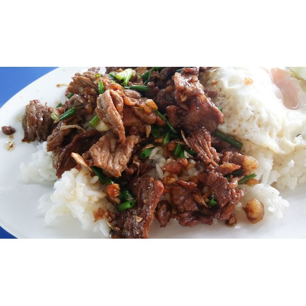 Beef tip cooked with peppers and onions served over white rice.