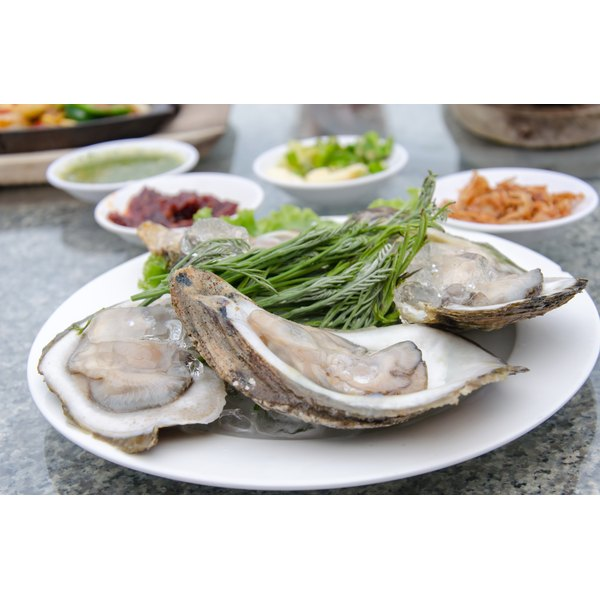 A plate of fresh oysters on a restaurant table.