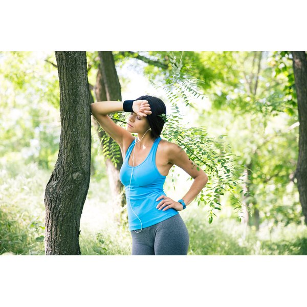 A woman is outdoors exercising.
