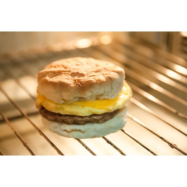 An egg biscuit sandwich on an oven rack.