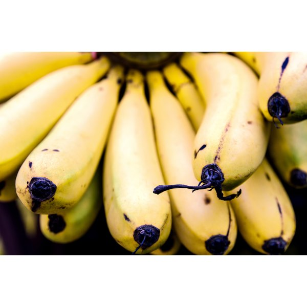 A close-up of a bunch of ripe bananas.