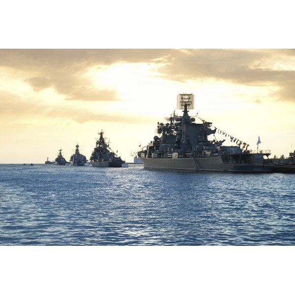 Military ships on the water.