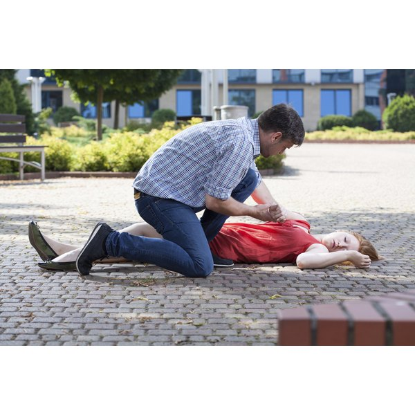 Woman having seizure on ground.