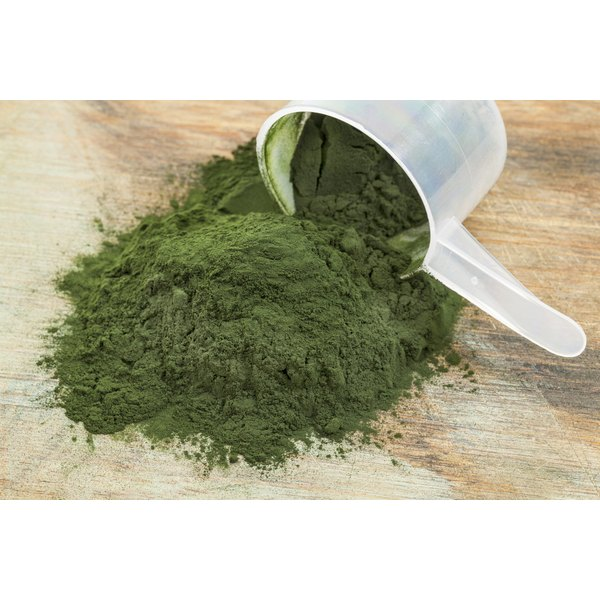 Spirulina powder spilling from scooper