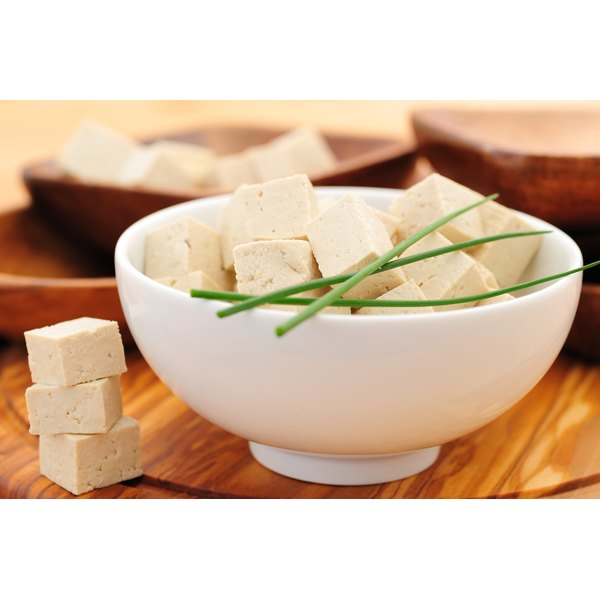 Close-up of a bowl of tofu cubes.