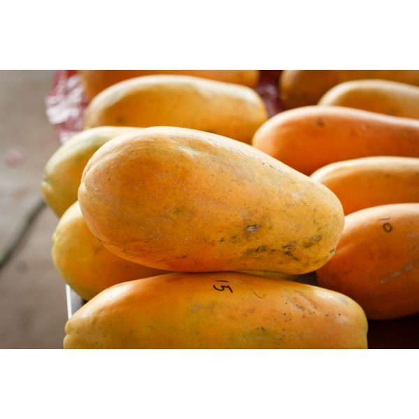 Papaya's for sale at a market.