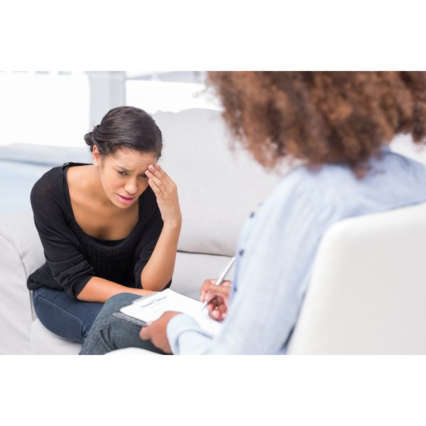 A young woman is talking to her therapist and doctor.